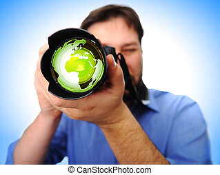 man with camera shooting earth