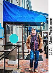 Man with digital camera at Faneuil Hall Boston