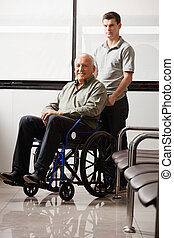 Man With Grandfather Sitting In Wheelchair