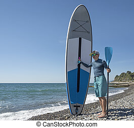 Man with stand-up paddle board