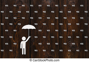 Man with umbrella standing in rain of words, abstract concept