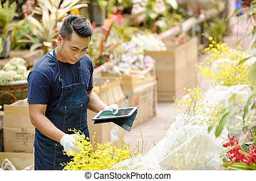 Man working with plants