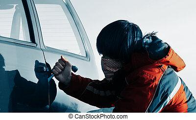Young man breacking door of a car