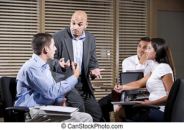 Hispanic manager talking with group of office workers