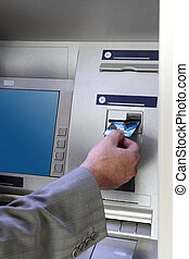 hand inserting card into cash dispense