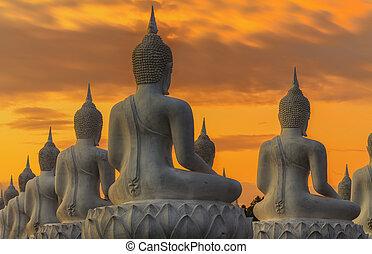 Buddha statue on sunset