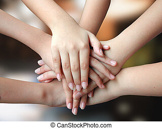 many hands putting together