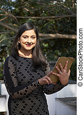 Mature Businesswoman With Tablet