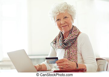 Mature Lady with Credit Card Shopping Online