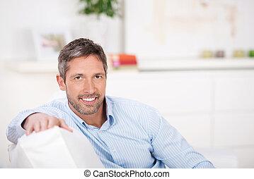 Mature Man Sitting On Sofa