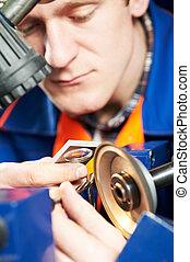 worker measuring detail