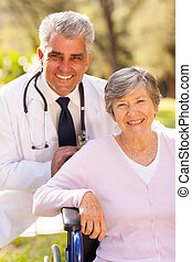 medical doctor and elderly patient