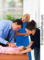 medical doctor examining baby