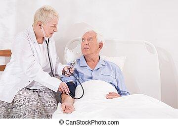 Medical examination of senior man