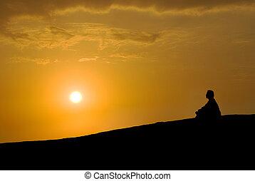 meditation under sunset