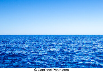 Mediterranean Sea blue seascape with clear horizon line and sky.