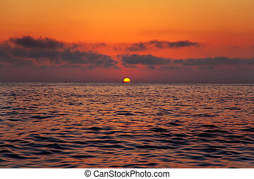 Mediterranean sea sunrise sunset with sun