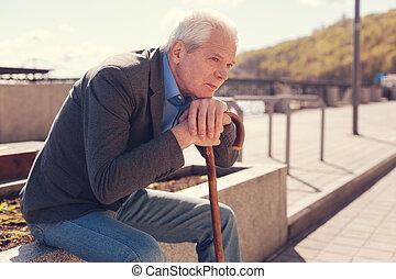 Melancholic senior man remembering his youth