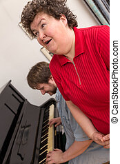 Mentally disabled woman singing in a music therapy