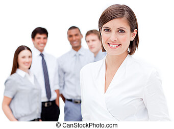 Merry manager in front of her team against a white background