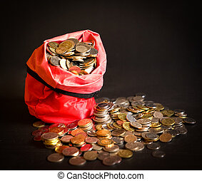 Metal coins in a red bag