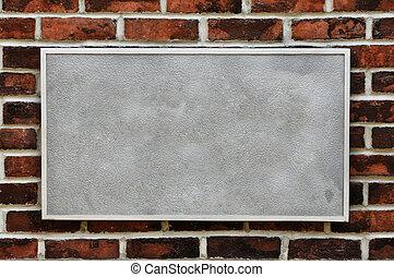 Metal Sign on Brick Wall