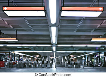 Here is a Montreal metro entrance and gate. This is where you have to pay you tickets to access to the metro platform. there is sign which the title have been removed so you can add whatever you want instead. All logos have been removed. this is a real underground scene.