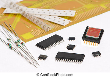 several integrated microelectronics components and yellow microcircuit board