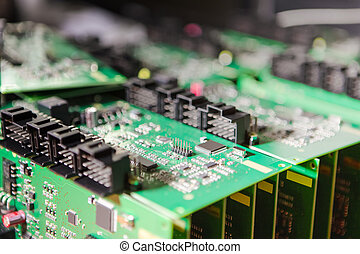 Microelectronics Concepts. Ready Automotive Printed Circuit Boards with Surface Mounted Components. A Few PCb Lying On Top of Batch.