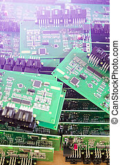 Microelectronics Concepts. Ready Automotive Printed Circuit Boards with Surface Mounted Components. PCb Lying On Top of Batch. Shallow DOF. Lens Flare Added.
