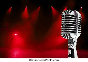 A retro, 60's style, metallic microphone on a colorful background.