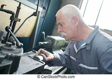 milling-machine operator works at machine
