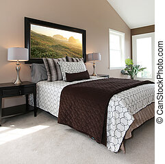 Bedroom with modern white and brown bed and nightstands