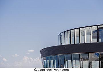 Modern building against the blue sky, modern design.