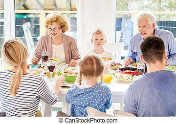 Modern Grandparents Enjoying Family Dinner