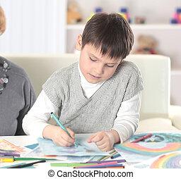 modern grandparents watch as their grandson draws
