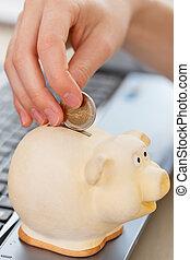 Money, finance. Girl with piggy