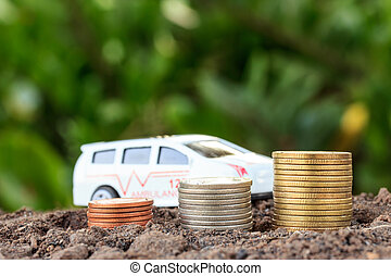 Money growth concept coins in soil .Collect money to build a car.