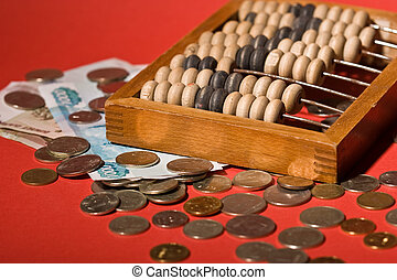 money series: old counting frame, coins and banknotes