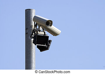 Monitoring camera at a metal post fastens.