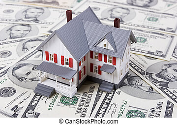 Two-story house with five dollar bills background