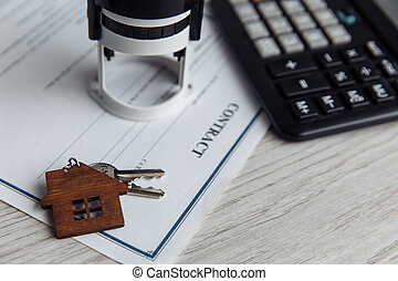 Mortgage loan agreement application with wooden house shaped keyring
