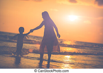 Mother with her daughter on the beach