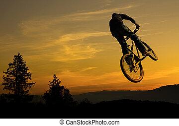 Mountain bike rider jump