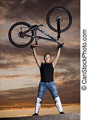 mountain biker silhouette in sunrise