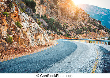 Mountain road at sunset in Europe. Landscape