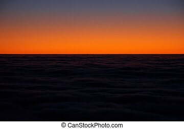 Mountain view of a cloudscape at sunset