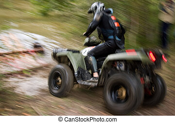 Sportsman riding quad bike at extreme competition