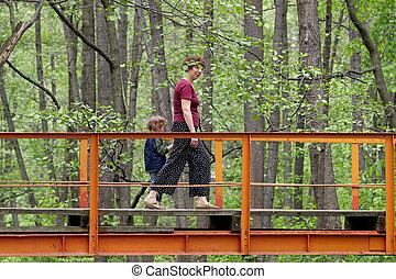 Mum and son on the bridge