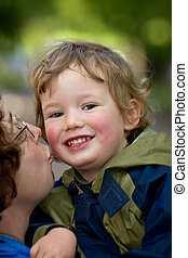 Mum kisses the boy